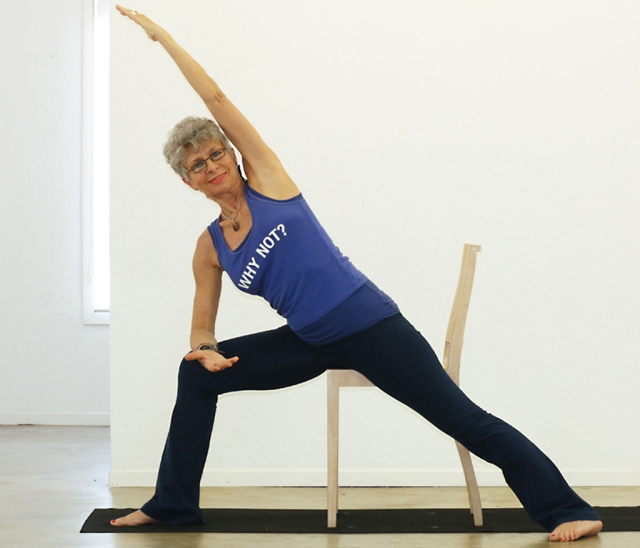 The extended side angle pose provides gentle stretching while also strengthening the bones even executed with the support of a chair.