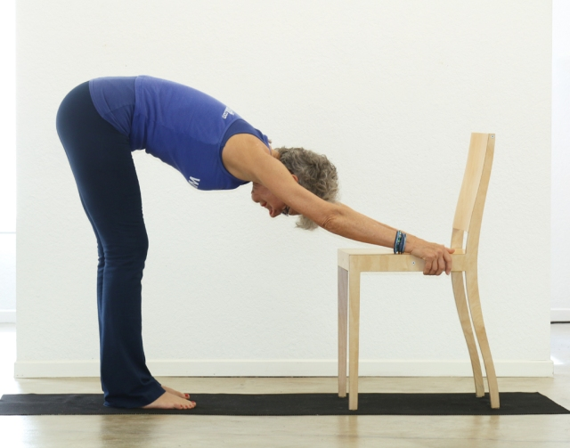 Downward-Facing Dog/Adho Mukha Svanasana with chair.
